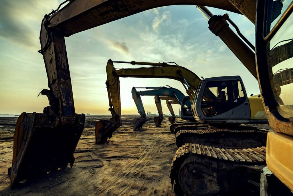 Row of construction equipment image for asset finance